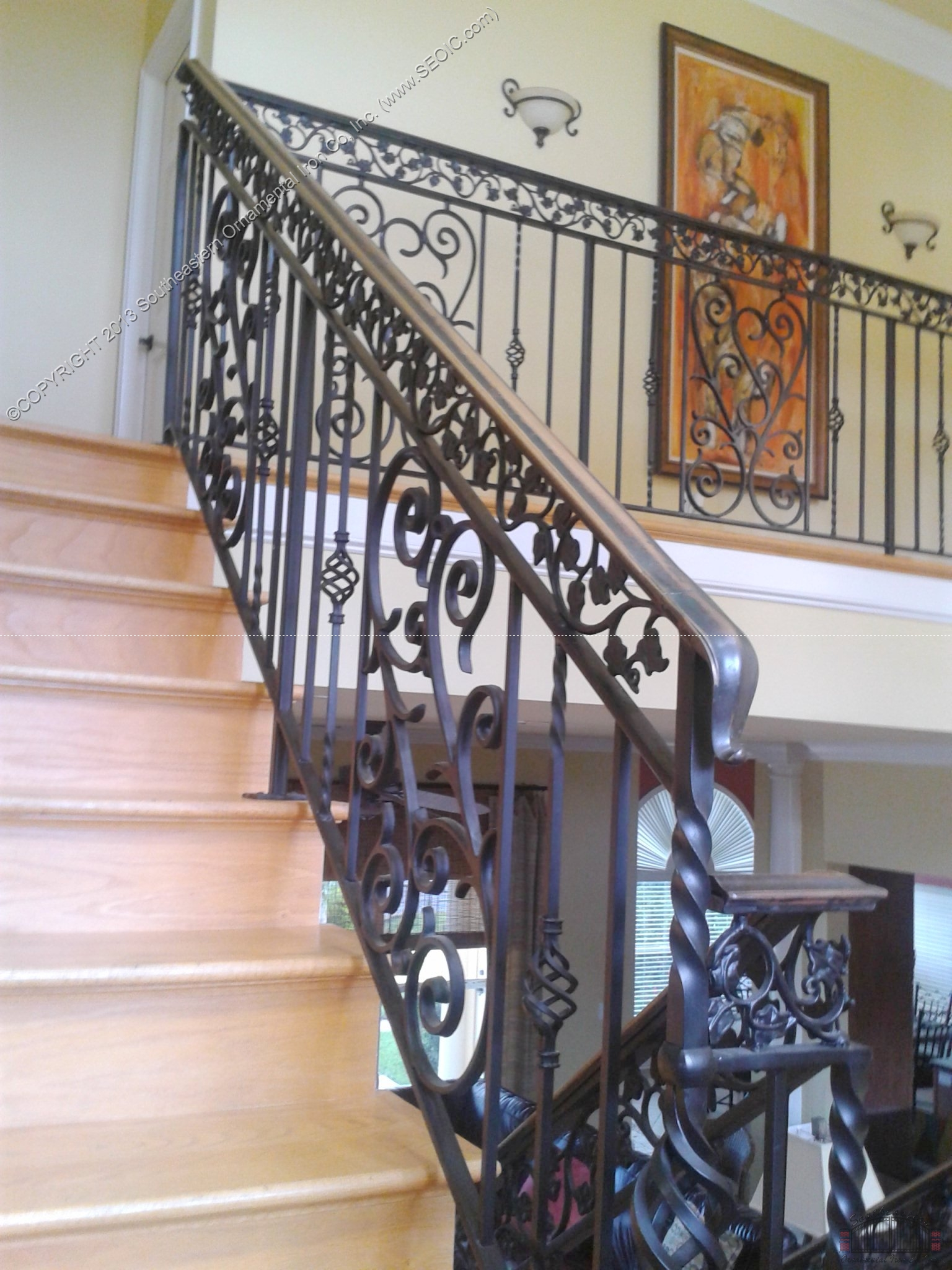 Wrought iron railing with bronze cap rail